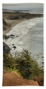 Storms Over A Rugged Coast Beach Towel