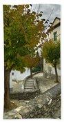 street in old Albaycin in Granada Beach Towel
