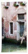 Stucco And Brick Canalside Building Venice Italy Beach Towel