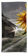 Sunflower Watch Beach Towel by Debra and Dave Vanderlaan