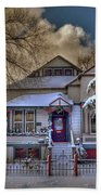The Decorated Little House In The Snow Beach Towel