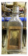 The Face In The Bottle  Beach Towel