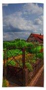 The Garden Gate Beach Towel by Debra and Dave Vanderlaan