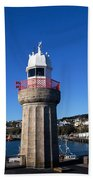 The Lighthouse And Fishing Harbour Beach Towel