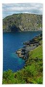 The Rugged Green Shore Beach Towel