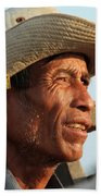 The Weathered Face Of An Ox Cart Driver Beach Towel