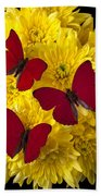 Three Red Butterflys Beach Towel by Garry Gay