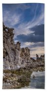 Tufas And Clouds Beach Towel