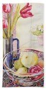 Tulips With Fruit In A Glass Bowl  Beach Towel by Joan Thewsey