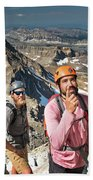 Two Male Hiker Stop To Look Beach Towel