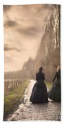 Two Victorian Ladies Walking On A Cobbled Path Beach Towel