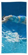 Underwater View Of Woman Diving Into Beach Towel