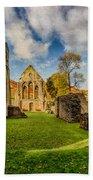 Valle Crucis Abbey Ruins Beach Towel by Adrian Evans