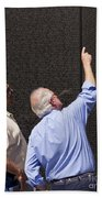 Veterans Look For A Fallen Soldier's Name On The Vietnam War Memorial Wall Beach Towel