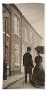 Victorian Couple On A Cobbled Street Beach Towel
