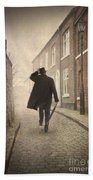 Victorian Man Running On A Cobbled Road Beach Towel