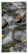Water Coloured Rocks Beach Towel