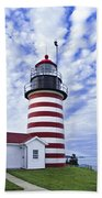 West Quoddy Head Lighthouse And Clouds Beach Towel