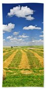 Wheat Farm Field And Hay Bales At Harvest In Saskatchewan Beach Towel