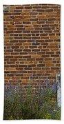 White Door In Brick Building Beach Towel
