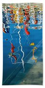 Wibbly Wobbly Flagpole Reflections Beach Towel