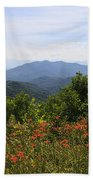 Wild Lilies With A Mountain View Beach Towel