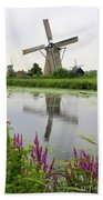 Windmills Of Kinderdijk With Flowers Beach Towel