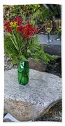 Wine And Red Flowers On The Rocks Beach Towel