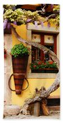 Wisteria And Yellow Wall In Alsace France Beach Towel