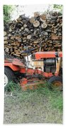 Wood Pile And Lawn Tractor Beach Towel