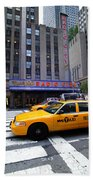Yellow Cabs Pass In Front Of Radio City Music Hall Beach Towel