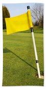 Yellow Flag On The Green Beach Towel