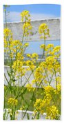 Yellow Flowers And A White Fence Beach Towel
