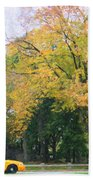 Yellow Nyc Taxi Driving Through Central Park Usa Beach Towel