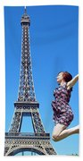 Young Woman Jumping Against Eiffel Tower Beach Towel
