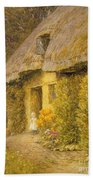A Child At The Doorway Of A Thatched Cottage  Beach Towel