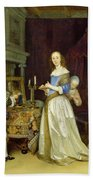 A Lady At Her Toilet Beach Towel by Gerard ter Borch