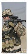A German Soldier Carries A Barrett Beach Sheet