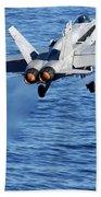 An Fa-18c Hornet Taking Off Beach Towel