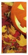 Carved Pumpkin On Fallen Leaves Beach Towel