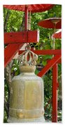 Row Of Bells In A Temple Covered By Red Umbrella Beach Towel