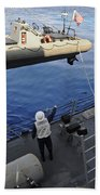 Sailors Lower A Rigid Hull Inflatable Beach Towel