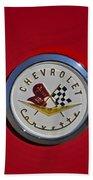1957 Red Corvette Emblem Beach Towel