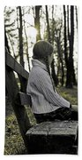 Girl Sitting On A Wooden Bench In The Forest Against The Light Beach Towel