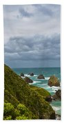 Nugget Point Light House And Dark Clouds In The Sky Beach Towel