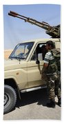 A Free Libyan Army Pickup Truck Beach Towel by Andrew Chittock