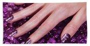 Woman Hand With Purple Nail Polish Beach Sheet