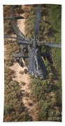 An Ah-64d Apache Helicopter In Flight Beach Towel