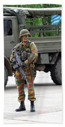 A Belgian Infantry Soldier Handling Beach Towel