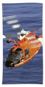 A Coast Guard Hh-65a Dolphin Rescue Beach Towel by Stocktrek Images